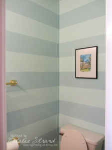Finished downstairs half-bath with stripes and some decorations.