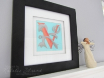 paper-pieced monogram and angel figurine
