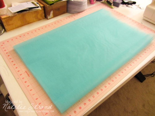 layer tulle so that folded edge is even