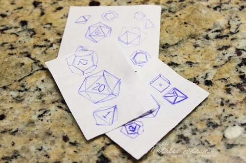 I did a lot of practice drawings to try to get the dice just right.