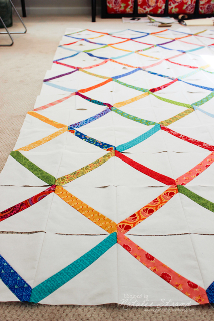 All of the squares have been sewn into half-row strips!