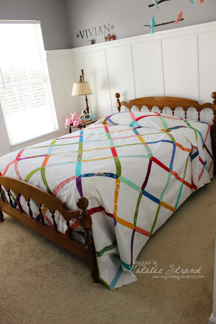 """test run"" of Vivian's quilt top on her bed."