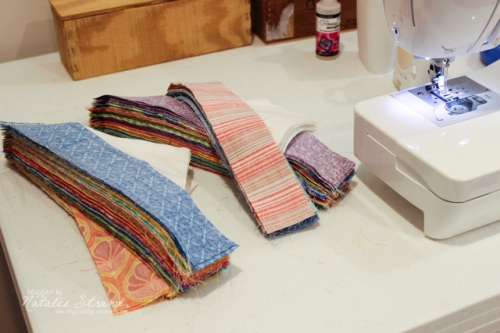 Today I finished attaching the first triangle to each strip for Vivian's quilt!