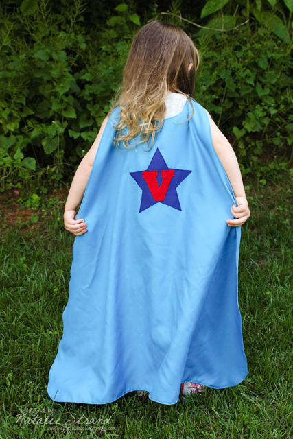 Vivian models her superhero cape--made from the first incarnation of my pattern.  It is a bit long right now, but she'll grow into it!