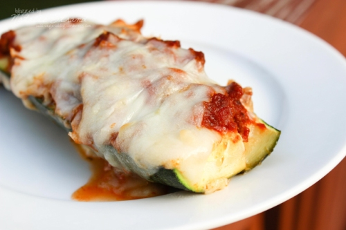 zucchini boats: halve a zucchini lengthwise and remove seeds; fill with ground-beef-and-marinara-mixture; top with mozzarella and bake. Delicious!! We had so much zucchini this summer that I was on the lookout for good recipes to use it!