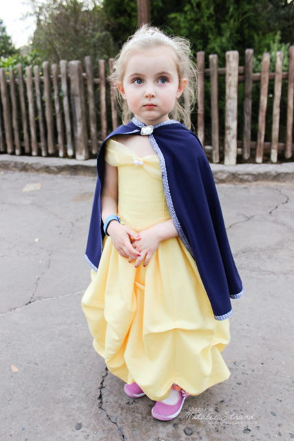 Vivian in her Belle dress, plus cloak sewn by Grameen