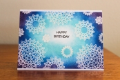 card made by white heat embossing medallion images and using fingers to blend pigment ink