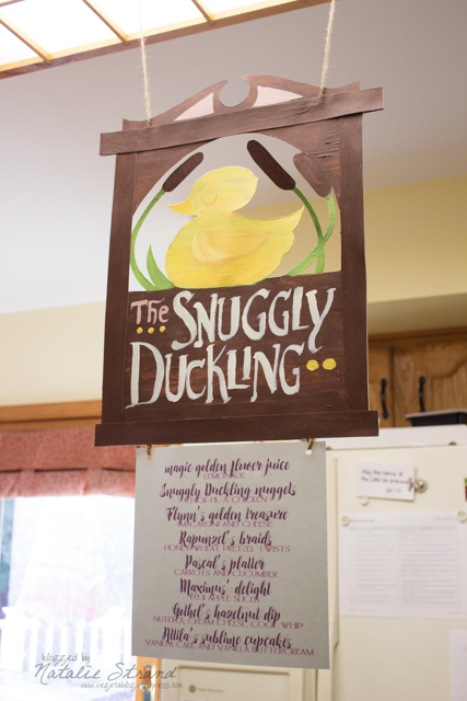 hand-painted Snuggly Duckling sign for displaying the menu
